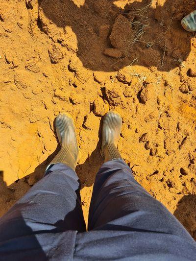 Gumboots in emali kenya red soil