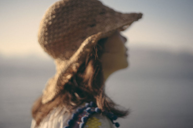 Close-up of woman by sea
