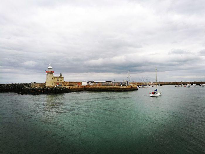 Howth harbor against sky