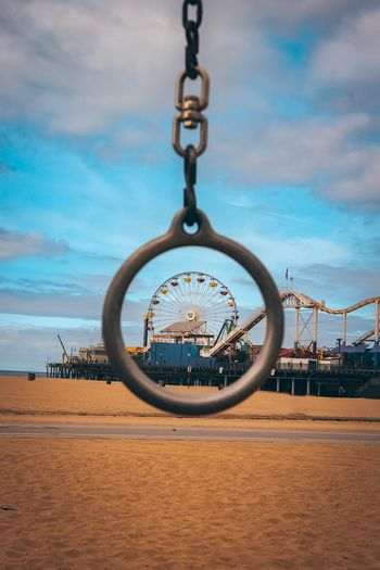 The Pier Cloud - Sky Sky Circle Geometric Shape Nature Land Day Shape Sand Metal Beach Chain No People Built Structure Hanging Outdoors Jewelry Architecture Sunlight