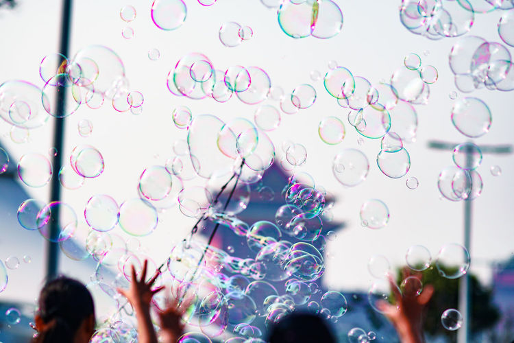 Reflection of people in bubbles