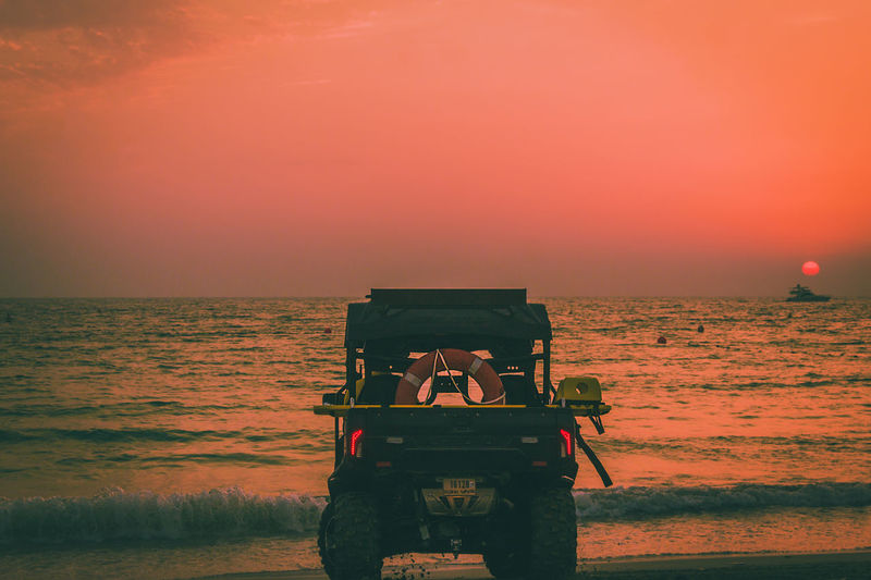 Beach Beach Photography Beach Truck Beauty In Nature Horizon Over Water Leisure Activity Nature Nature Nature Lover Nature Photography Nature_collection Red Red Sky Red Sky At Sunset Sea Sky Standing Sunset Sunset_collection Tranquil Scene Tranquility Truck Vacations Water Wave
