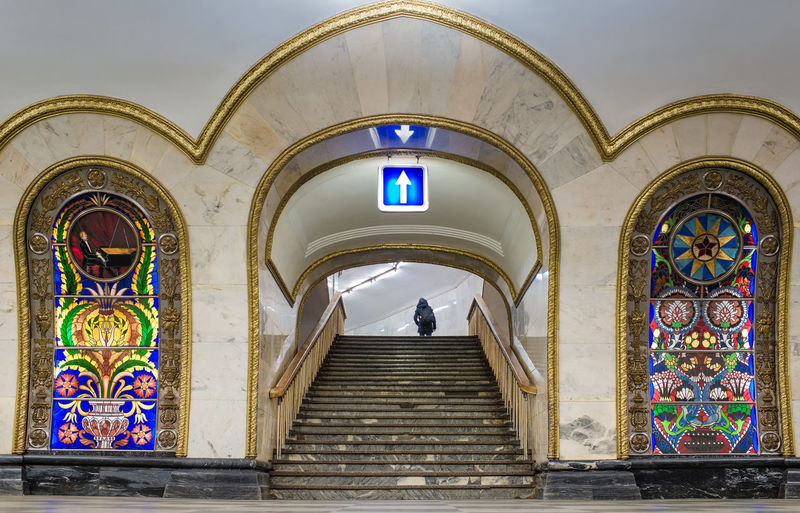 Illuminated Arrow Symbol Over Staircase At Novoslobodskaya