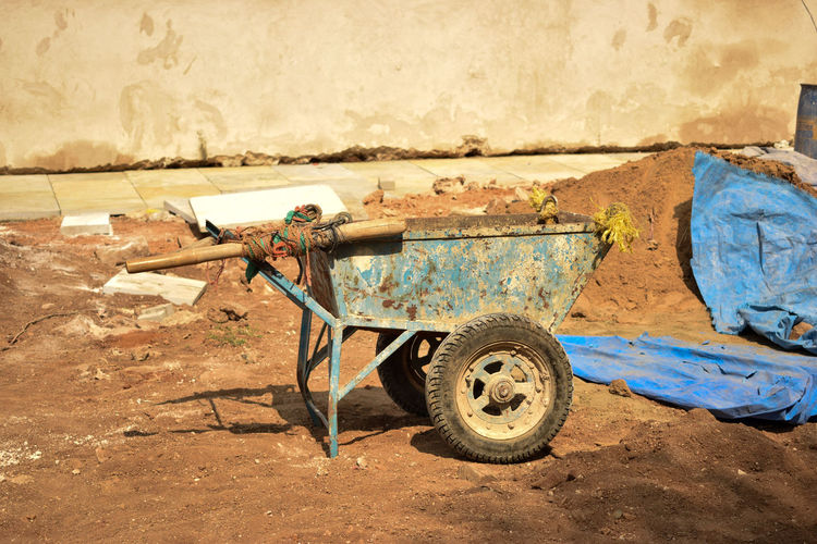 Rusty wheelbarrow at construction site