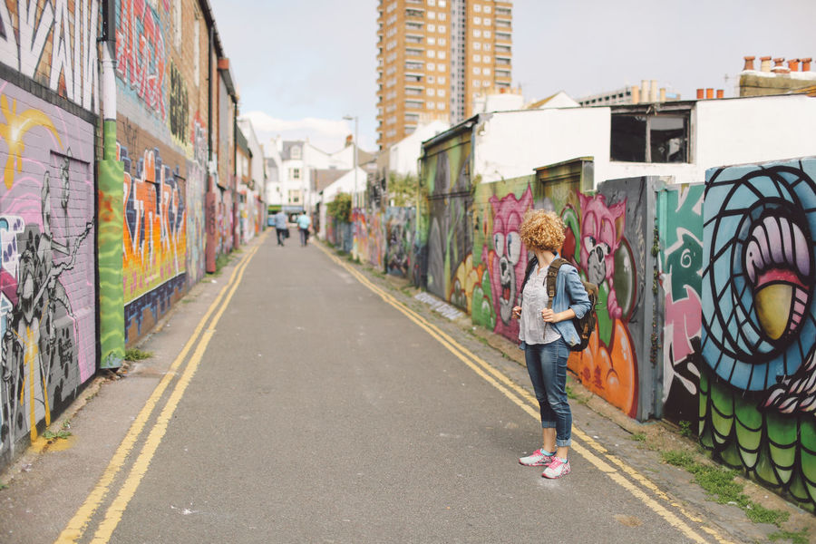 Architecture Art Blonde Brighton Building Building Exterior Built Structure City City Life Curly Hair Day Diminishing Perspective Downtown Girl Graffiti Graffiti Graffiti Art Multi Colored Outdoors Road Store Street Street Art The Way Forward Vanishing Point Been There. Connected By Travel Fashion Stories