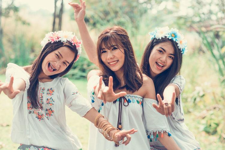 Portrait of smiling female friends gesturing