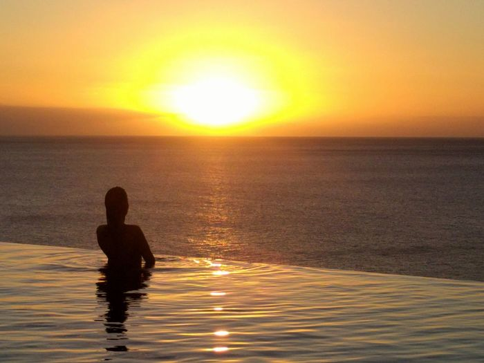 Pool Sunset Sun Sea One Person People Sunlight Water Reflection Tranquility Vacations Dusk Swimming Outdoors