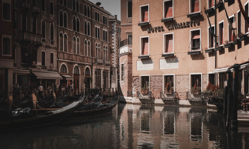 Reflection of buildings in canal venice italy