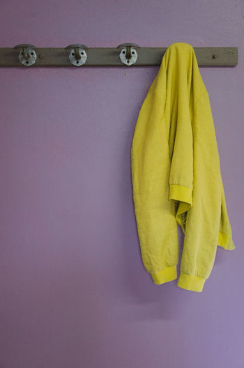 50mm Cloakroom Close-up Clothes Coat Complementary Colors Day Dressing Room Hanged Hanging Jacket Locker Locker Room Nikon No People Objects Purple Quit Smoking  Three Vest Wall Yellow Lieblingsteil