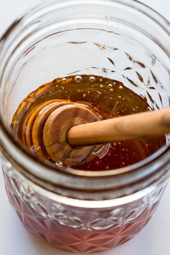 A jar of honey Isolated Natural Wood Close Up Close-up Food Honey Jar No People Stick Still Life Sweetener Wand