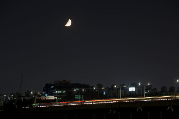 Architecture Bridge Bridge - Man Made Structure Built Structure City City Life Cityscape Dark Development Glowing Illuminated Light Modern Moon Moon Nature Night Night View No People Outdoors River Sky Yanghwadaegyo