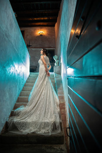 Adult Architecture Bride Celebration Digital Composite Event Fashion Full Length Illuminated Indoors  Life Events Men Newlywed One Person Real People Rear View Standing Wedding Wedding Dress Women