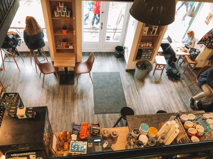 At the cafe Indoors  Business Real People Men Restaurant Table Store Food And Drink Group Of People Adult Choice Collection Seat Women Large Group Of Objects Cafe Retail  High Angle View Group Variation Cozy Cafe Coffee Shop Budapest People At The Cafe