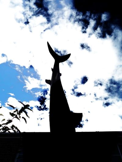 Architecture Black. Blue Cloud - Sky Day Ediyt Landmark. No People No People. Beauty In Nature Diamond Pattern Outdoors Sculpture Shark Sculpture In Rooftop. Silhouette.. Sky Statue Sunlight Tree The Week On EyeEm
