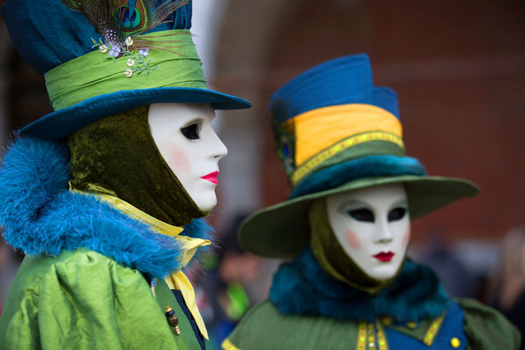 Man and woman in costume during venice carnival