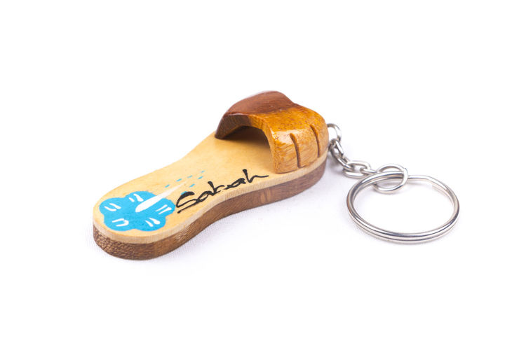 Sabah Borneo key chain souvenir on a white background. Traditional sandal shaped. ASIA Collection Destination Flower Gift Holiday Journey Key Chain Malaysia Rafflesia Sabah Sabah Borneo Sabah Malaysia Souvenir Travel Trip Vacations White Background
