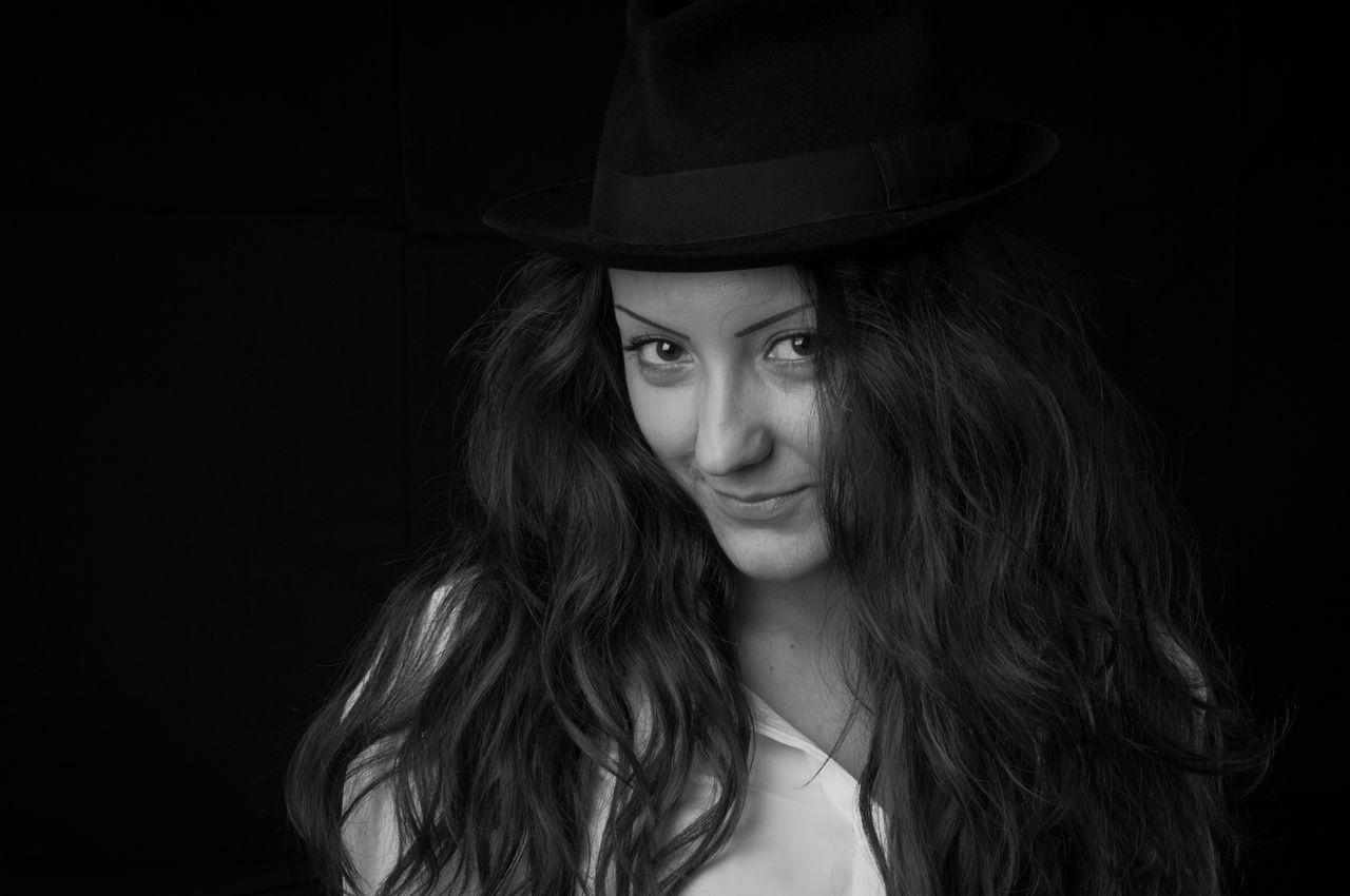Portrait Of Young Woman Standing In Darkroom