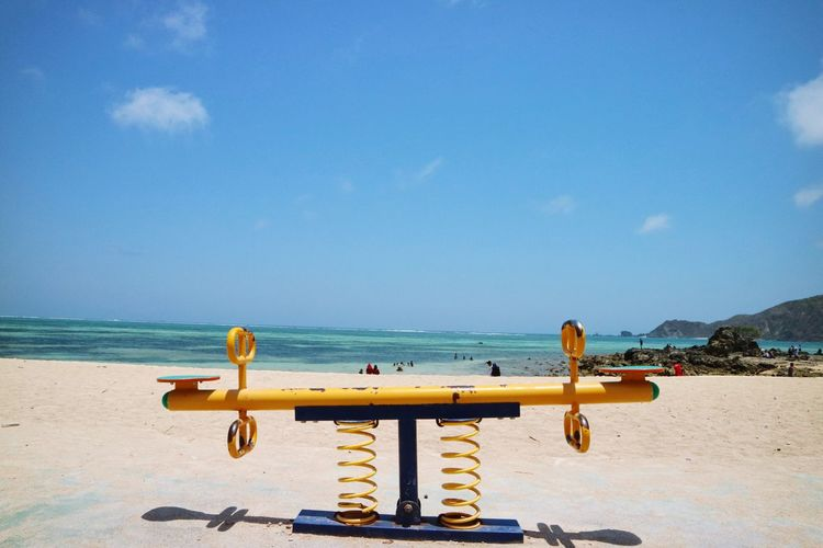 Seesaw in the Mandalika Beach Lombok Indonesia Holiday Beachescape Seasalt Beachphotography Blue Sky Wonderful Indonesia Wonderful Cloud - Sky Seesaw Playing Playground Water Sea Beach Blue Clear Sky Sand Sky Horizon Over Water Seascape Ocean Slide - Play Equipment Holiday Moments Human Connection Human Connection A New Perspective On Life EyeEmNewHere Capture Tomorrow Moments Of Happiness
