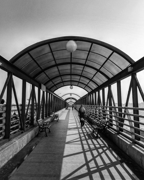It is better to walk alone than with a crowd going in the wrong direction Bnw_collection Mobilephotography Mobileshot Shotonmia1 Xiaomiphotography Shine Shadow Light Bright Blackandwhite Bnw Built Structure Architecture Day Bridge - Man Made Structure Outdoors Sky No People