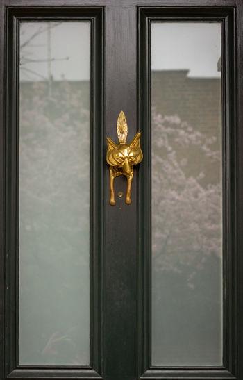 Close-up of window on door