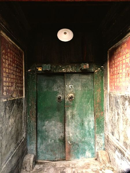 Beside the door there are two sentences of special period in our country. It's unusual to saw nowadays. Door Green Doors Closed Old Entrance Architecture History Wooden Brick Wall Iphonephotography The Secret Spaces The Architect - 2017 EyeEm Awards