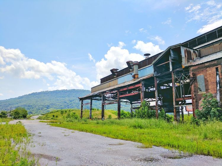 Architecture Outdoors Built Structure Road Day Mountain Travel Destinations Cloud - Sky No People Sky Grass Building Exterior Nature Urban Chattanooga Factories Factory Industrial Abandoned Delapidated Run-down Low Angle View Architecture Rural Scene Rural