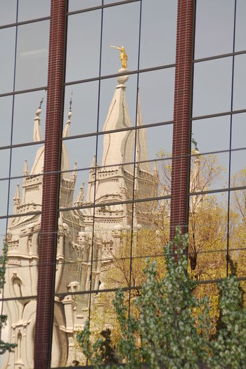 Architecture Building Building Exterior Built Structure Church City Day Glass - Material History Landmark Mormon No People Outdoors Reflection Religion Temple Temple Square Tower Tree Utah Window
