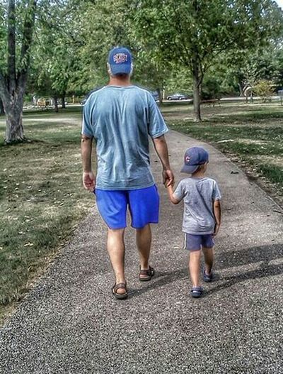 Father and son walking Modern Father Dad Dad And Son Check This Out Eye4photography  EyeEm Gallery People Portrait EyeEm Best Shots Handinhand Hand In Hand Walking Around Father & Son Editorial  Color Taking Pictures Daddy And Son Father And Son Father Family Walk Walking Colorful Close Up Closeup