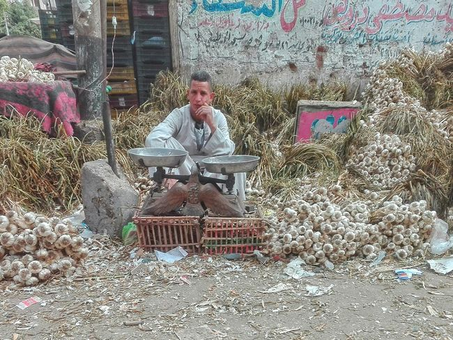 The Portraitist - 2017 EyeEm Awards Uper Egypt Poor Man Market Mobilephotography Streetphotography Outdoors One Man Only Working Lifestyles Day Photooftheday One Person Real People Full Length Men Adult People Only Men Young Adult Adults Only