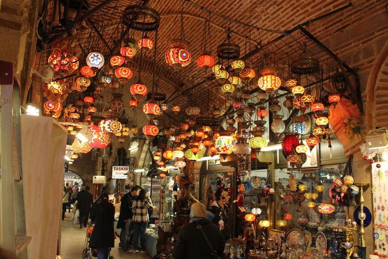 People at illuminated market stall