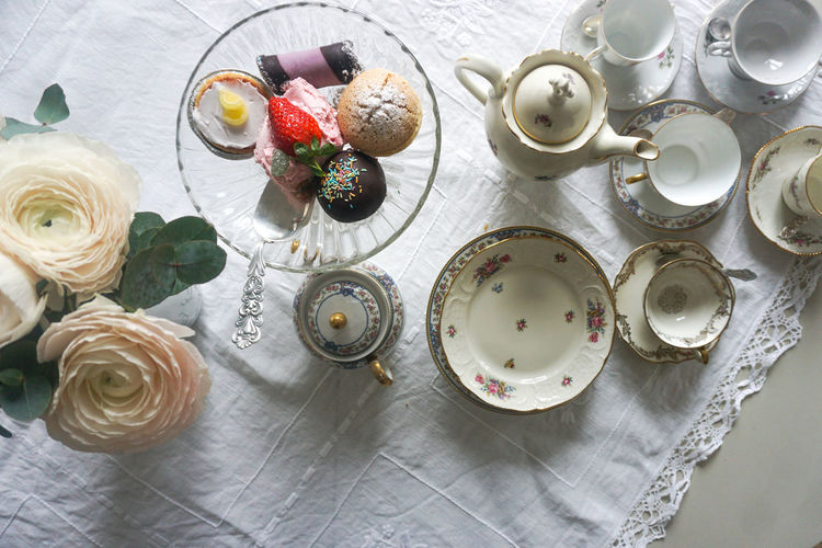 tea time Tea Tea - Hot Drink Tea Time Tea Time Hot Drink Cake Cakes Cake Time Bouquet Ranunculus Directly Above Table Table Cloth Table Setting Plate Pot Table High Angle View Variation Close-up Flower Head Blooming Large Group Of Objects Fragility