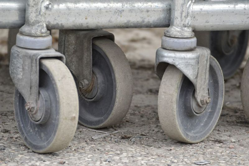 Close-up of trolley wheels
