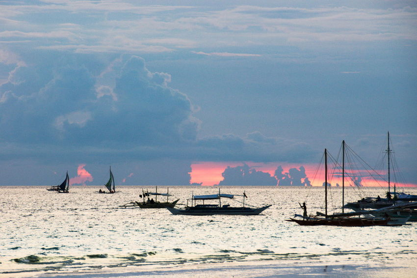 Boats Beach Beauty In Nature Boat Cloud Cloud - Sky Idyllic Journey Mast Nature Nautical Vessel Non-urban Scene Outdoors Sailboat Sailing Scenics Sea Silhouette Sky Sunset The Essence Of Summer Tourism Tranquil Scene Tranquility Water