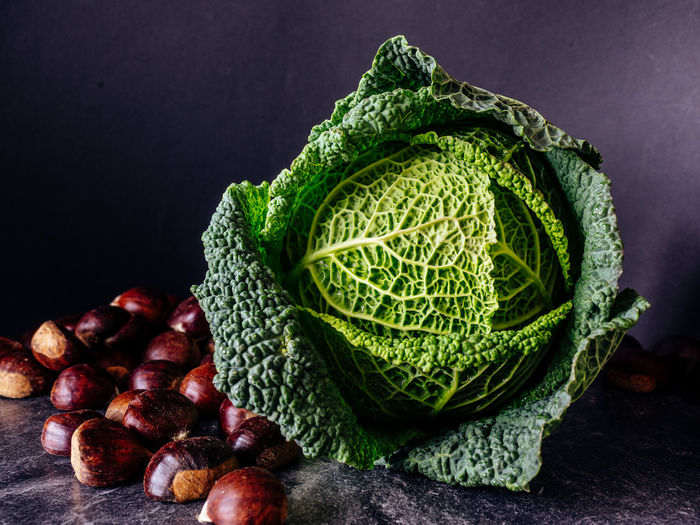 Savoy Cabbage and Chestnuts Chestnuts Close-up Dark Detail Focus On Foreground Food Food And Drink Foodphotography Green Color Healthy Eating Healthy Lifestyle Leaf Leaf Vein Natural Pattern No People Organic Paris Ripe Savoy Cabbage Selective Focus Vegetable