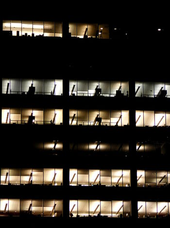 Overtime. Closed Glass Indoors  Manhattan Neversleep New York City Noblinds Overtime Pattern Transparent Window The Street Photographer - 2016 EyeEm Awards The Architect - 2016 EyeEm Awards The Photojournalist - 2016 EyeEm Awards Cities At Night Finding New Frontiers The Graphic City