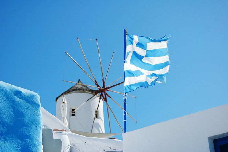 Flying the Flag Oia Santorini Blue Clear Sky No People Nature Outdoors Architecture Greek Islands Greece Photos Wood Travel