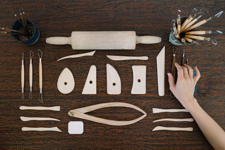Neatly Organized Tools for Ceramic Work Artisan Ceramic Art Craft Craft Tool Craftmanship Directly Above High Angle View Human Body Part Human Hand Organized Preparation  Process Shaping Tools Table Tools Wood - Material Workshop