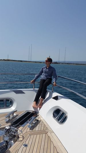 Nautical Vessel Sea Water One Person Sunglasses Only Men Mode Of Transport Men Sailing Summer One Man Only Boy Cyprus Mediterranean  Transportation Full Length Yacht Boat Deck Recreational Boat Sky Adults Only Adult Day