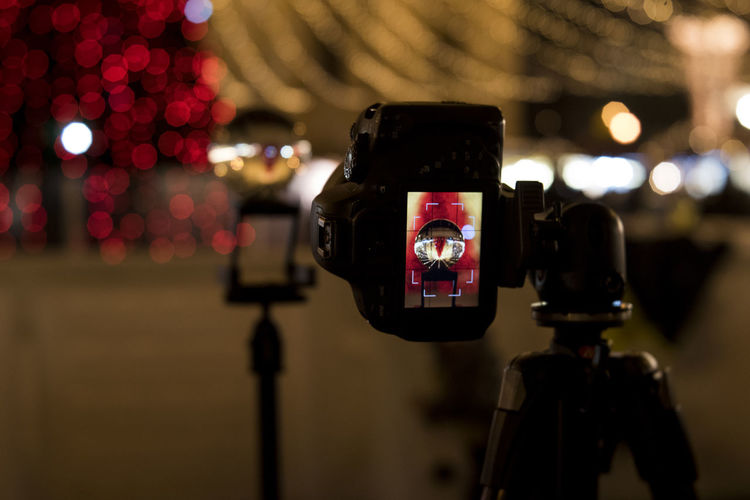 Close-Up Of Camera On Tripod With Crystal Display