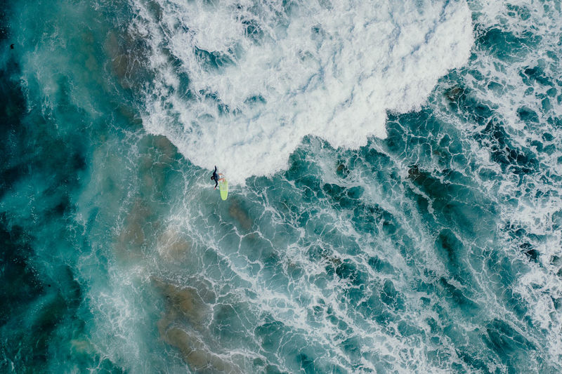 Sport Water Sea Motion Aquatic Sport Wave Surfing Beauty In Nature High Angle View One Person Nature Day Lifestyles Leisure Activity Waterfront Unrecognizable Person Real People Outdoors Power In Nature Surfer Waves Crashing Water Sport Australia Drone