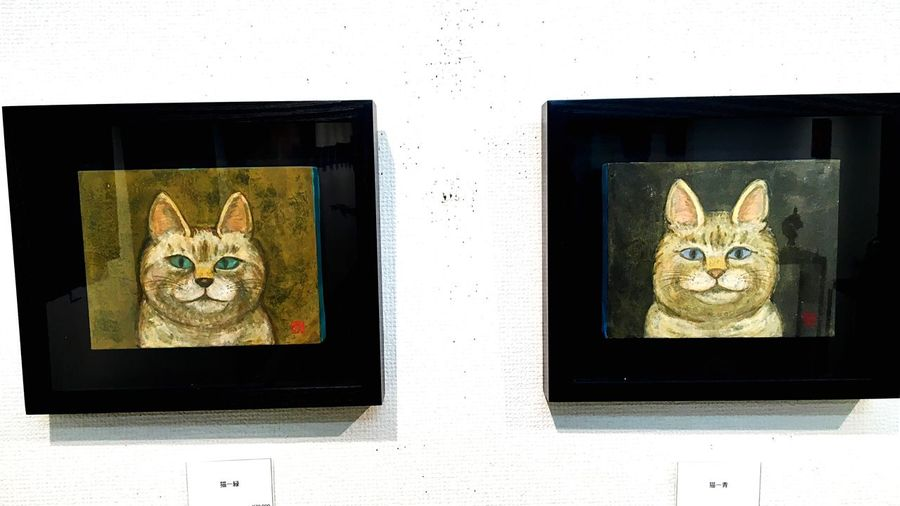 Domestic Cat Looking At Camera Feline Indoors  Mammal Animal Themes No People Pets Day Built Structure Portrait Domestic Animals Architecture Close-up Art Japanese Painting Cat 猫 日本画 Teacher A Solo Exhibition 個展 Today I went to see my teacher 's solo exhibition. This picture is drawn by my teacher. It is drawn with Japanese paint. It is a person who taught me art when I was a junior high school student.