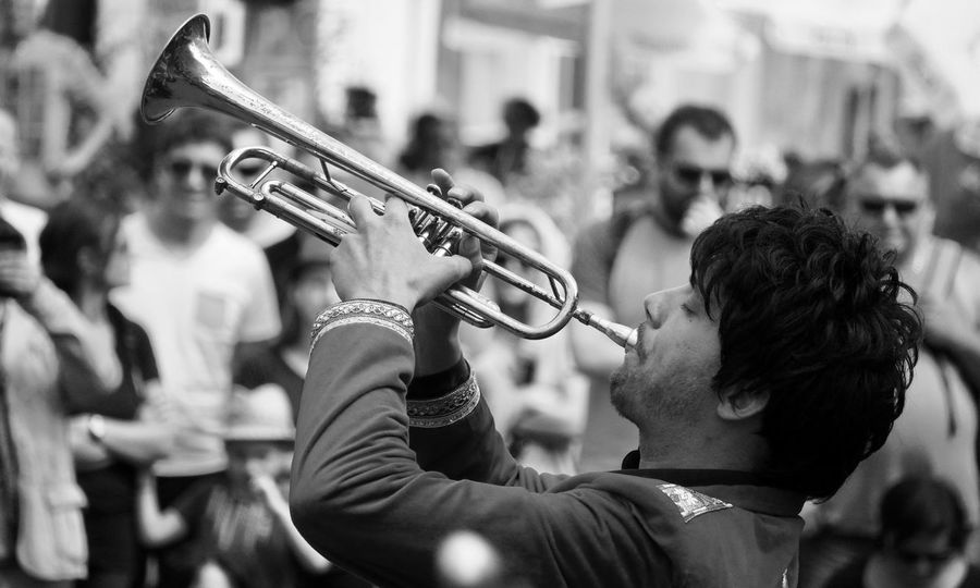 Arts Culture And Entertainment Blackandwhite Photography Fanfare Focus On Foreground Large Group Of People Marching Band Men Music Musical Instrument Musician Outdoors Performance Playing Real People Skill  Street Trumpet Wind Instrument