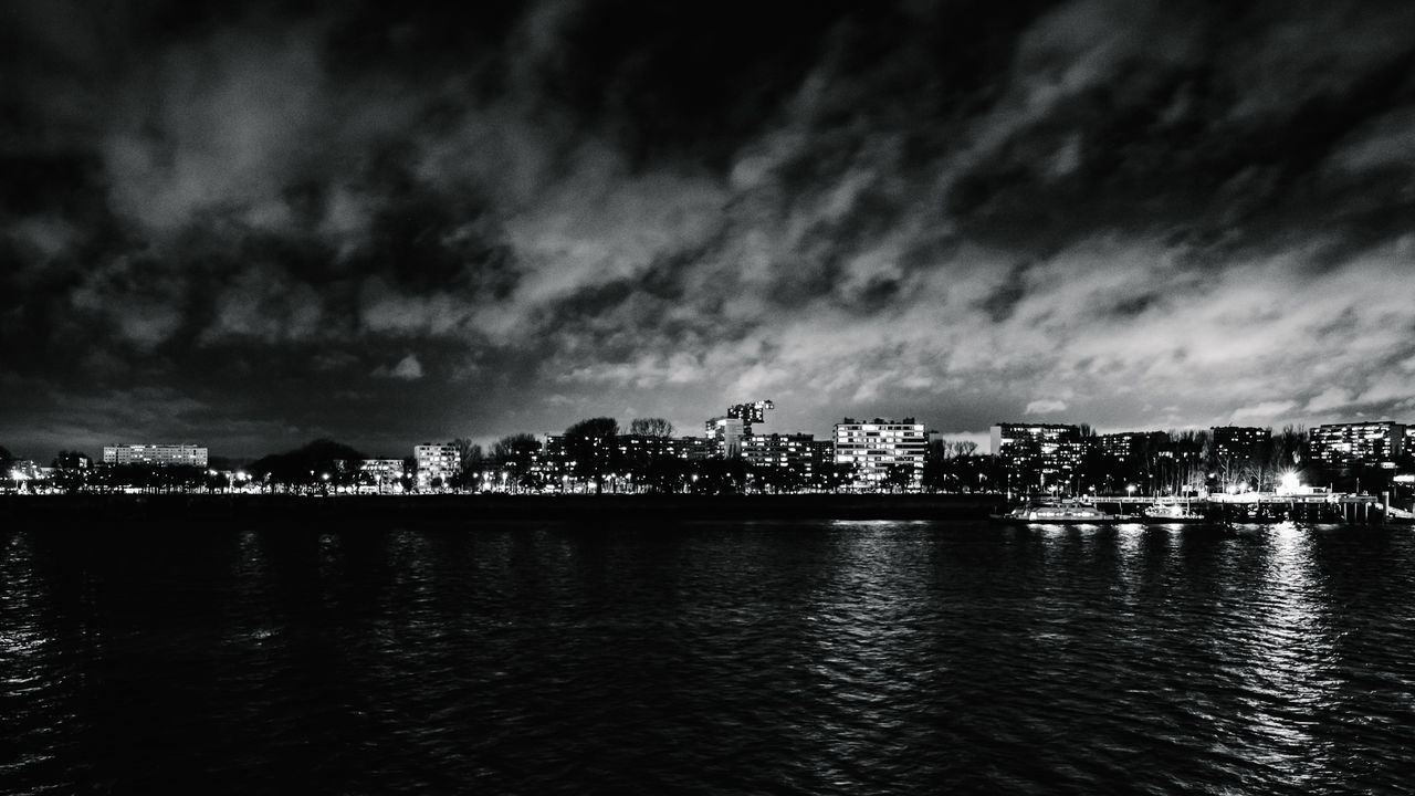CITY AT NIGHT AGAINST SKY