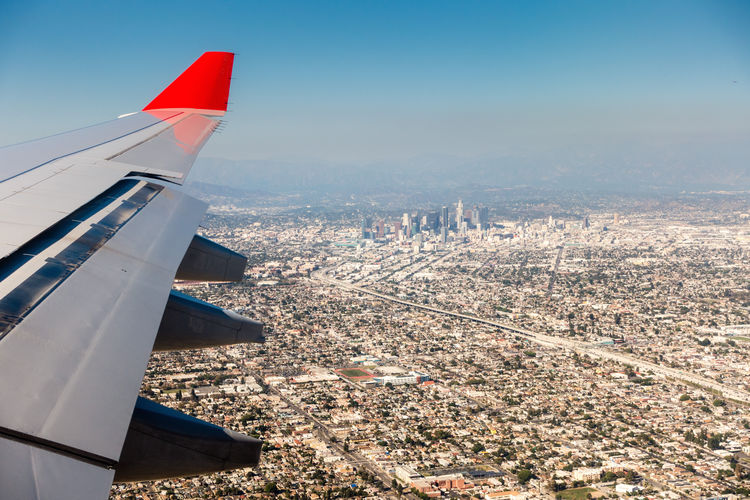 Air Vehicle Airplane Aircraft Wing Flying Architecture Transportation Mode Of Transportation No People Day City Cityscape Built Structure Nature Building Exterior Aerial View Sky Mid-air Travel Outdoors on the move