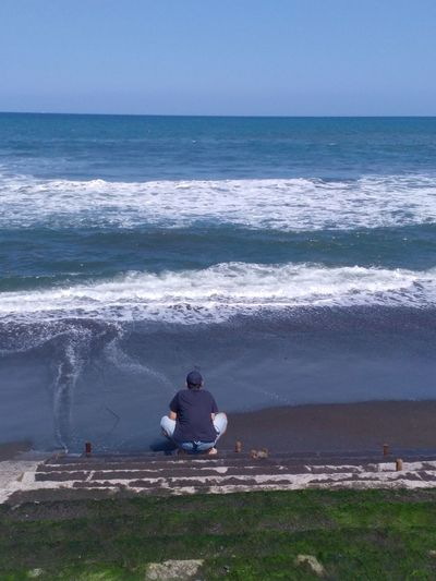 Me and the sea Sea Water Beach Land Motion Wave Nature Lifestyles Real People Beauty In Nature Sitting Sport Sky Leisure Activity People Horizon Men Horizon Over Water Relaxation Outdoors Looking At View