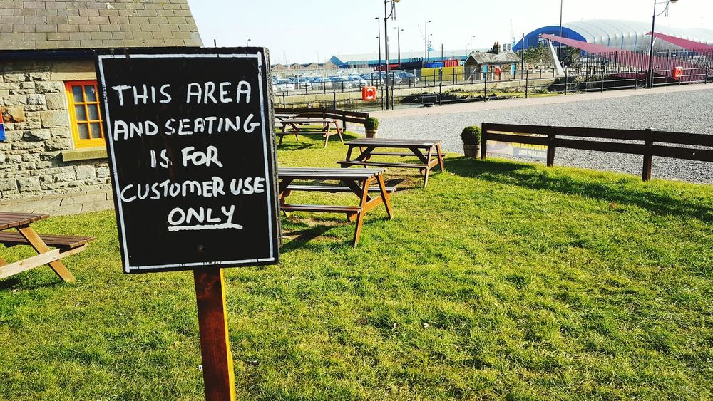 Signboard Signage Seating Bench Seating Area Passiveaggressive Benches Cardiff Bay Sunny Day Cold And Sunny  Chalk Board Cardiff Wales Cymru