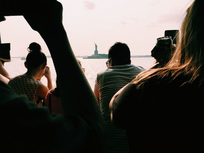 Tourists photographing statue of liberty