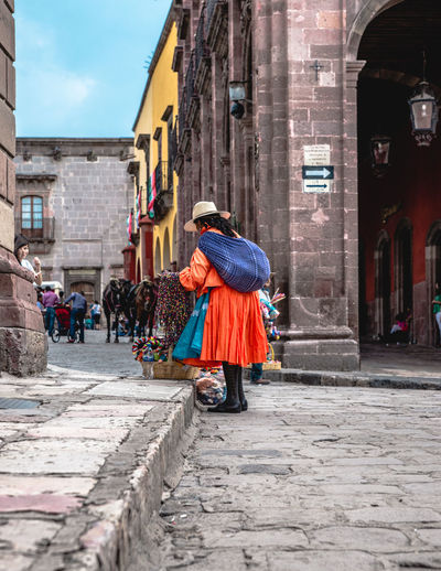Day Outdoors San Miguel De Allende Mexico Travel Travel Destinations Tranquility Travel Photography Architecture Architecture_collection Colorful Town Town Scape Building Exterior Built Structure Real People City Clothing Full Length Women Walking Street Traditional Clothing People Incidental People Adult Rear View Building Lifestyles
