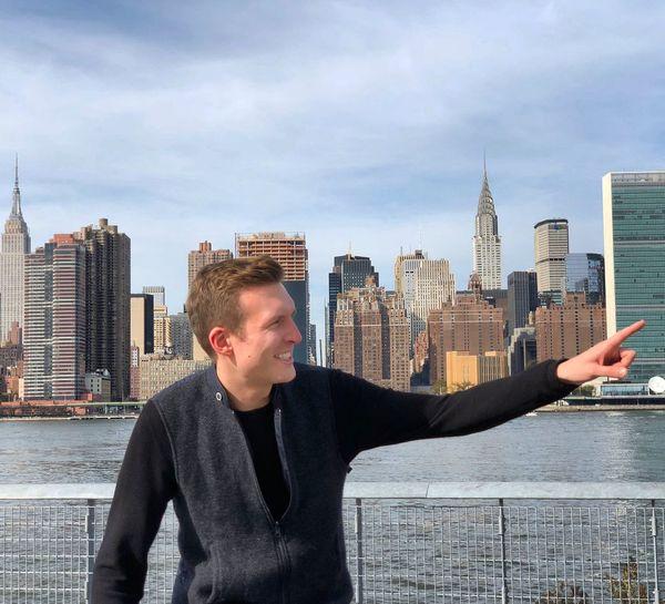 Mid adult man standing against manhattan skyline