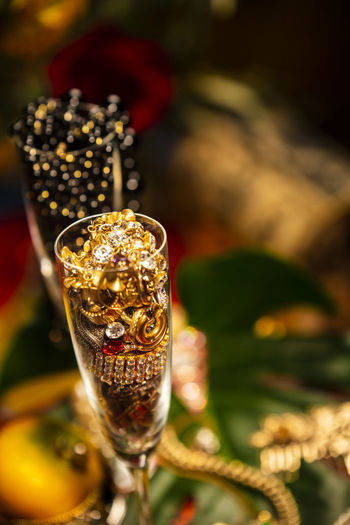 Celebrational Abundance Abundance Wealth Celebration Decoration Jewelry Pearls Glass Focus On Foreground Refreshment Close-up Food And Drink Drink Gold Colored Alcohol No People Wine Champagne Champagne Flute Selective Focus Still Life Drinking Glass Luxury Wineglass Precious Gem